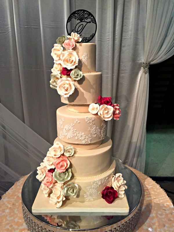 Ivory Wedding Cake With Cascading Gumpaste Flowers