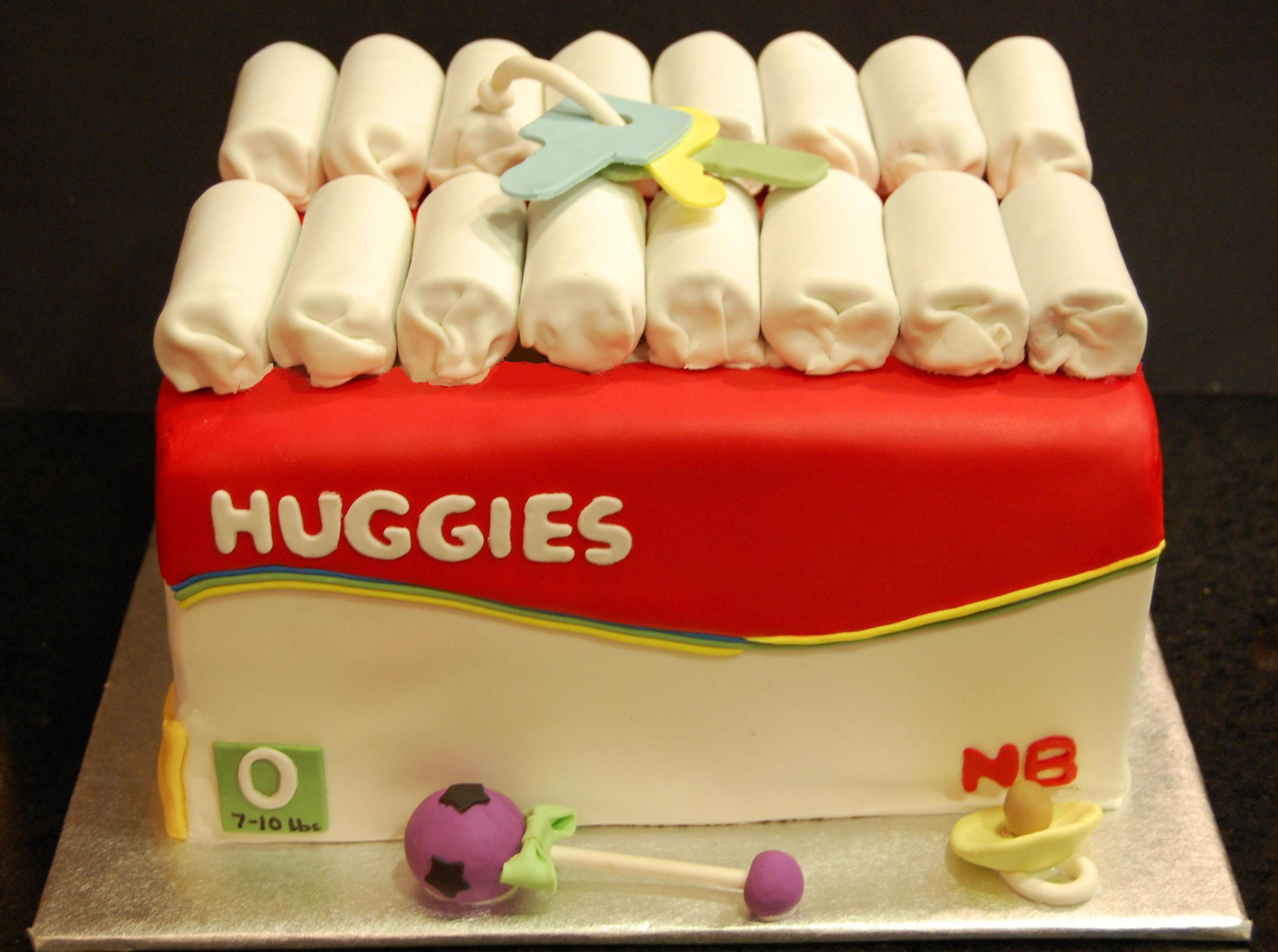 Baby shower cake designed like a huggies diaper box. everything edible
