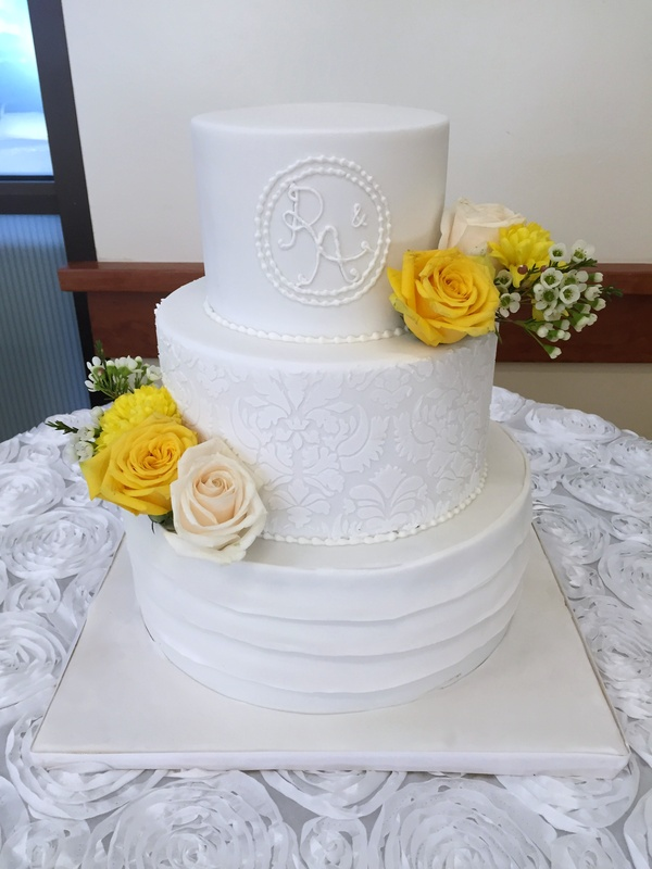 White wedding cakes with fresh flowers